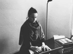 Photo of Falon typing on laptop